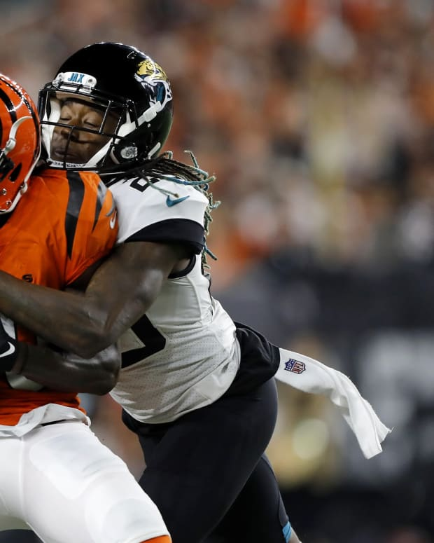Sep 30, 2021; Cincinnati, Ohio, USA; Cincinnati Bengals wide receiver Mike Thomas (80) is tackled by Jacksonville Jaguars safety Andre Cisco (38) during the second quarter at Paul Brown Stadium. Mandatory Credit: Joseph Maiorana-USA TODAY Sports