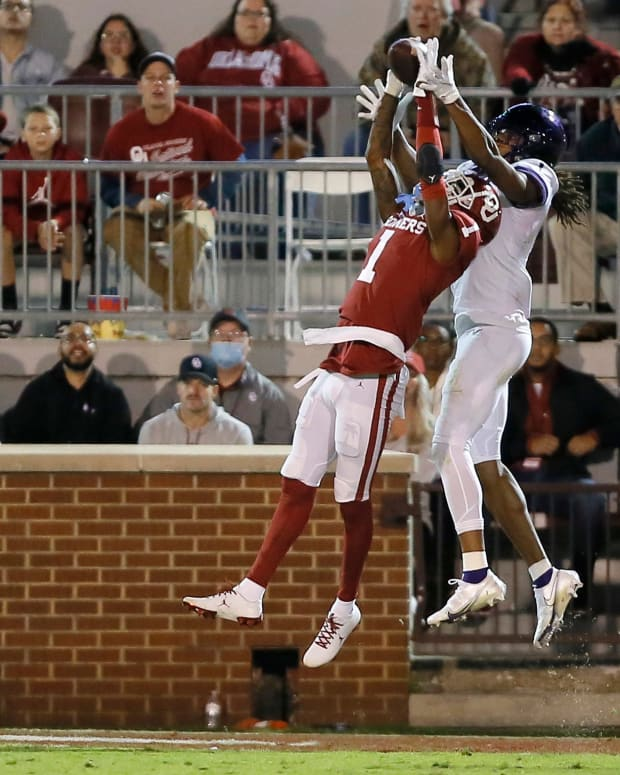 TCU's Quentin Johnston (1) catches a touchdown pass over Oklahoma's Joshua Eaton (1) during a college football game between the University of Oklahoma Sooners (OU) and the TCU Horned Frogs at Gaylord Family-Oklahoma Memorial Stadium in Norman, Okla., Saturday, Oct. 16, 2021. Oklahoma won 52-31.