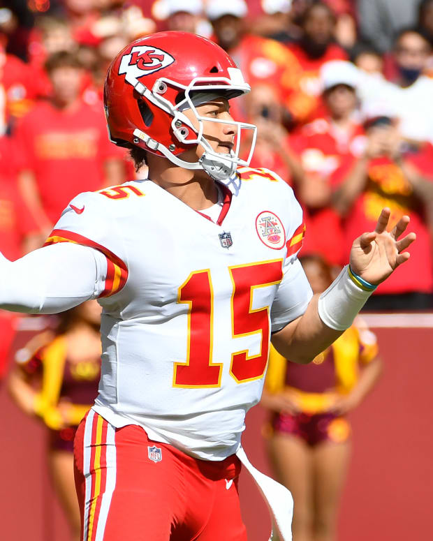 Oct 17, 2021; Landover, Maryland, USA; Kansas City Chiefs quarterback Patrick Mahomes (15) attempts a pass against the Washington Football Team during the first quarter at FedExField. Mandatory Credit: Brad Mills-USA TODAY Sports