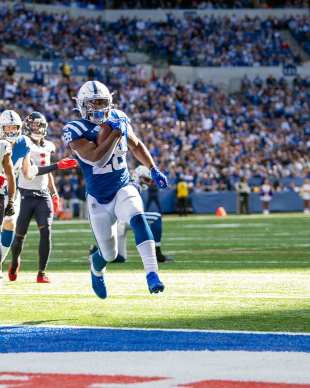 Oct 17, 2021; Indianapolis, Indiana, USA; Indianapolis Colts running back Jonathan Taylor (28) runs the ball into the end zone for a touchdown during the second half against the Houston Texans at Lucas Oil Stadium. The Colts win 31-3.
