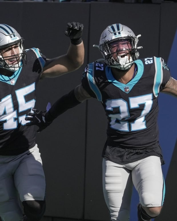 Oct 17, 2021; Charlotte, North Carolina, USA; Carolina Panthers safety Kenny Robinson (27) celebrates with fullback Giovanni Ricci (45) after his score against the Minnesota Vikings during the second half at Bank of America Stadium.