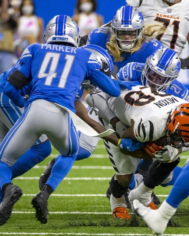 Oct 17, 2021; Detroit, Michigan, USA; Detroit Lions free safety Tracy Walker III (21) tackles Cincinnati Bengals running back Joe Mixon (28) in the first quarter at Ford Field. Mandatory Credit: David Reginek-USA TODAY Sports