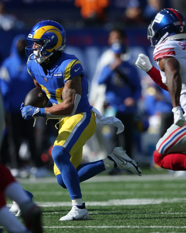 Oct 17, 2021; East Rutherford, New Jersey, USA; Los Angeles Rams free safety Taylor Rapp (24) runs back an interception against the New York Giants during the second quarter at MetLife Stadium.