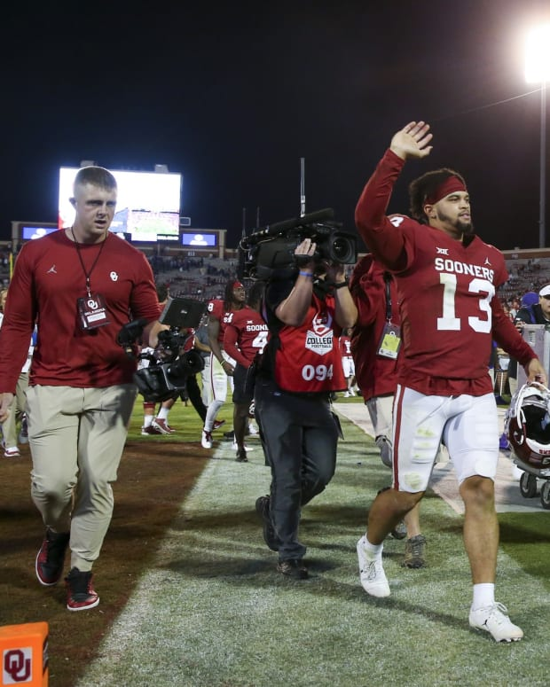 Oct 16, 2021; Norman, Oklahoma, USA; Oklahoma Sooners quarterback Caleb Williams (13) waves to fans after the game against the TCU Horned Frogs at Gaylord Family-Oklahoma Memorial Stadium.