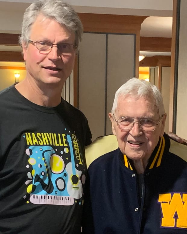 Jim Thompson, the oldest living UW football letterman, shown with his son, Jim.