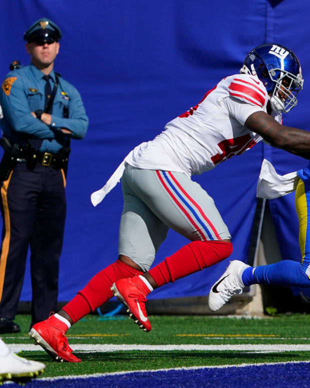 Los Angeles Rams running back Darrell Henderson (27) scores a touchdown with pressure from New York Giants linebacker Tae Crowder (48). The Giants fall to the Rams, 38-11, at MetLife Stadium on Sunday, Oct. 17, 2021, in East Rutherford.