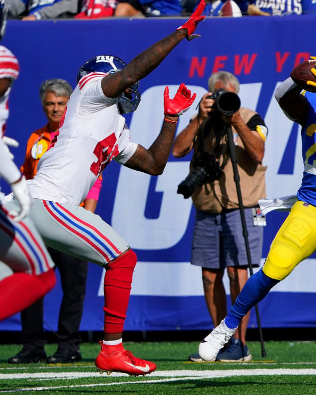Los Angeles Rams running back Darrell Henderson (27) makes a touchdown catch over New York Giants linebacker Tae Crowder (48) in the first half. The Giants fall to the Rams, 38-11, at MetLife Stadium on Sunday, Oct. 17, 2021, in East Rutherford.