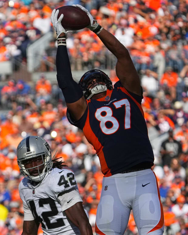 Denver Broncos tight end Noah Fant (87) pulls in a reception past Las Vegas Raiders inside linebacker Cory Littleton (42) in the first half at Empower Field at Mile High.