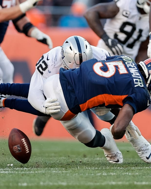 Las Vegas Raiders defensive tackle Solomon Thomas (92) knocks the ball away from Denver Broncos quarterback Teddy Bridgewater (5) in the third quarter at Empower Field at Mile High.