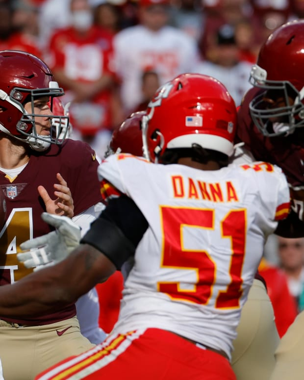 Oct 17, 2021; Landover, Maryland, USA; Washington Football Team quarterback Taylor Heinicke (4) drops back to pass under pressure. From. Kansas City Chiefs defensive end Mike Danna (51) during the third quarter at FedExField. Mandatory Credit: Geoff Burke-USA TODAY Sports