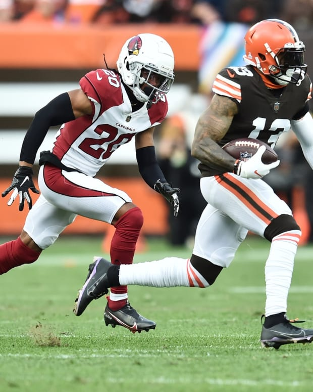 Oct 17, 2021; Cleveland, Ohio, USA; Cleveland Browns wide receiver Odell Beckham Jr. (13) runs with the ball after a catch as Arizona Cardinals cornerback Marco Wilson (20) defends during the first half at FirstEnergy Stadium. Mandatory Credit: Ken Blaze-USA TODAY Sports