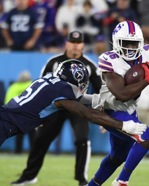 Bills running back Devin Singletary (26) runs for a first down during the first half against the Tennessee Titans at Nissan Stadium.