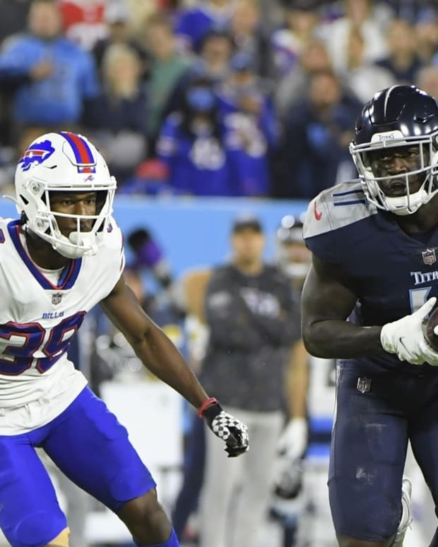 Titans wide receiver A.J. Brown (11) makes a catch as Buffalo Bills cornerback Levi Wallace (39) chases during the second half at Nissan Stadium.