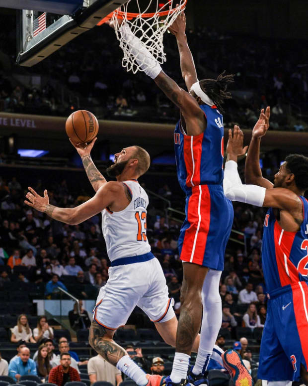 Oct 13, 2021; New York, New York, USA; New York Knicks guard Evan Fournier (13) shoots the ball as Detroit Pistons forward Jerami Grant (9) and guard Josh Jackson (20) defend during the second half at Madison Square Garden. Mandatory Credit: Vincent Carchietta-USA TODAY Sports