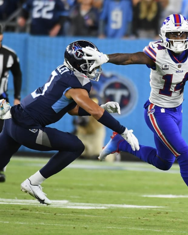 Buffalo Bills wide receiver Stefon Diggs (14) fights off a tackle attempt by Tennessee Titans cornerback Caleb Farley (3) during the first half at Nissan Stadium.