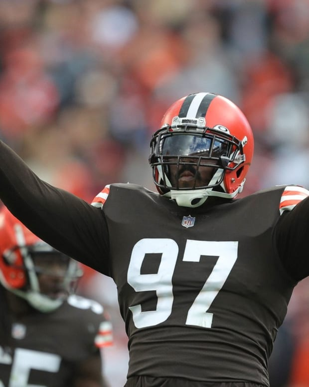Cleveland Browns defensive tackle Malik Jackson (97) gets the crowd pumped up on third down during the first half of an NFL football game against the Arizona Cardinals at FirstEnergy Stadium, Sunday, Oct. 17, 2021, in Cleveland, Ohio. [Jeff Lange/Beacon Journal] Browns 19