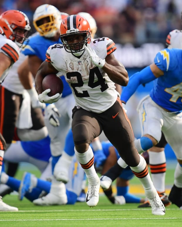 Oct 10, 2021; Inglewood, California, USA; Cleveland Browns running back Nick Chubb (24) runs the ball against the Los Angeles Chargers during the second half at SoFi Stadium. Mandatory Credit: Gary A. Vasquez-USA TODAY Sports