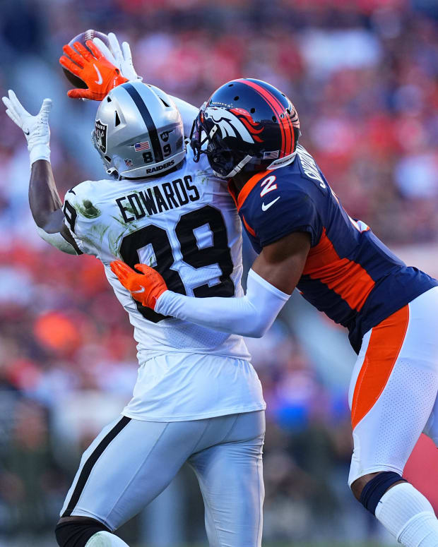Denver Broncos cornerback Pat Surtain II (2) breaks up a pass to Las Vegas Raiders wide receiver Bryan Edwards (89) in the second half at Empower Field at Mile High.