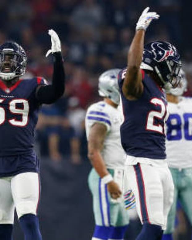 HOUSTON, TX - OCTOBER 07: Whitney Mercilus #59 of the Houston Texans and Justin Reid #20 signal for the crowd to make noise in the first half against the Dallas Cowboys at NRG Stadium on October 7, 2018 in Houston, Texas. (Photo by Tim Warner/Getty Images)
