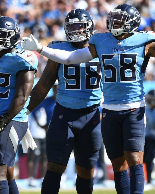 Tennessee Titans linebacker Ola Adeniyi (92) and Tennessee Titans linebacker Harold Landry (58) and Tennessee Titans defensive tackle Jeffery Simmons (98) celebrate after sacking Indianapolis Colts quarterback Carson Wentz (2) during the second half at Nissan Stadium.