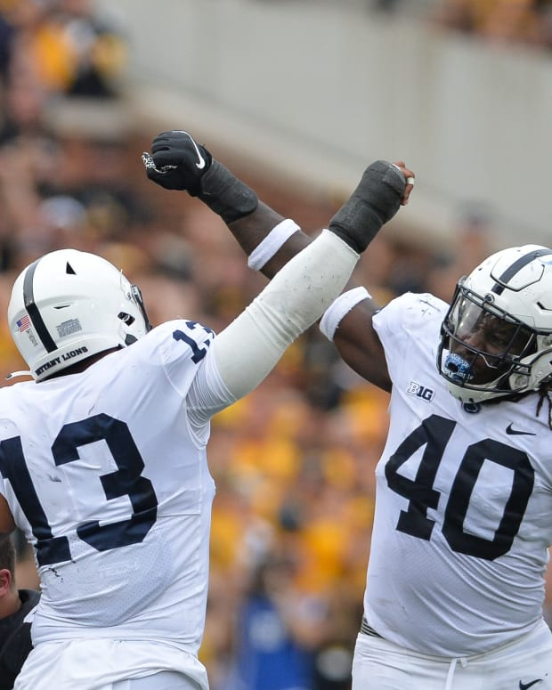 Penn State's Ellis Brooks (13) and Jesse Luketa celebrate against Iowa.