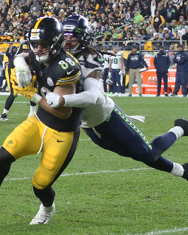 NFL: Seattle Seahawks at Pittsburgh Steelers Oct 17, 2021; Pittsburgh, Pennsylvania, USA; Pittsburgh Steelers tight end Pat Freiermuth (88) is tackled after a pass reception by Seattle Seahawks defensive back Ryan Neal (26) during the third quarter at Heinz Field. Pittsburgh won 23-20 in overtime. Mandatory Credit: Charles LeClaire-USA TODAY Sports