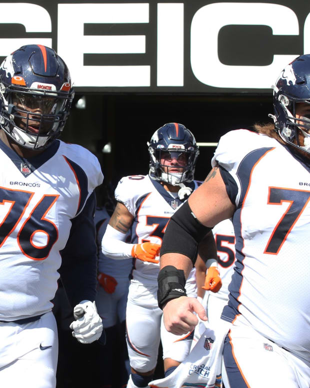 Denver Broncos offensive tackle Calvin Anderson (76) and guard Quinn Meinerz (77) take the field to play the Pittsburgh Steelers at Heinz Field. The Steelers won 27-19.
