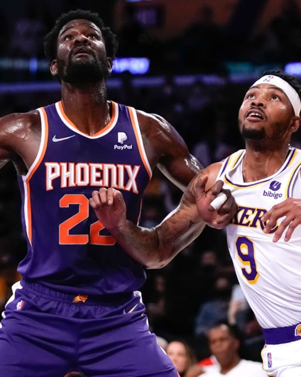 Oct 10, 2021; Los Angeles, California, USA; Phoenix Suns center Deandre Ayton (22) and Los Angeles Lakers forward Kent Bazemore (9) during the first quarter at Staples Center. Mandatory Credit: Robert Hanashiro-USA TODAY Sports