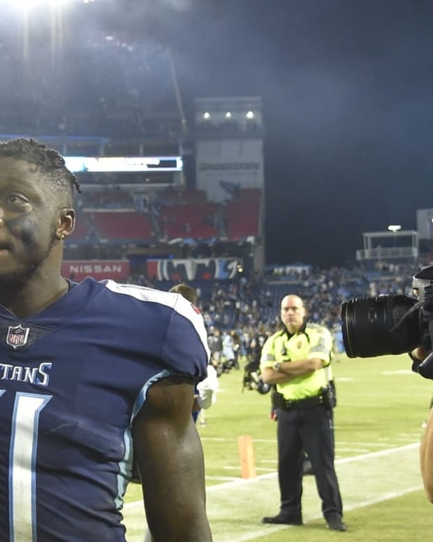 Tennessee Titans wide receiver A.J. Brown (11) celebrates the win as he walks off the field against the Buffalo Bills during the second half at Nissan Stadium.