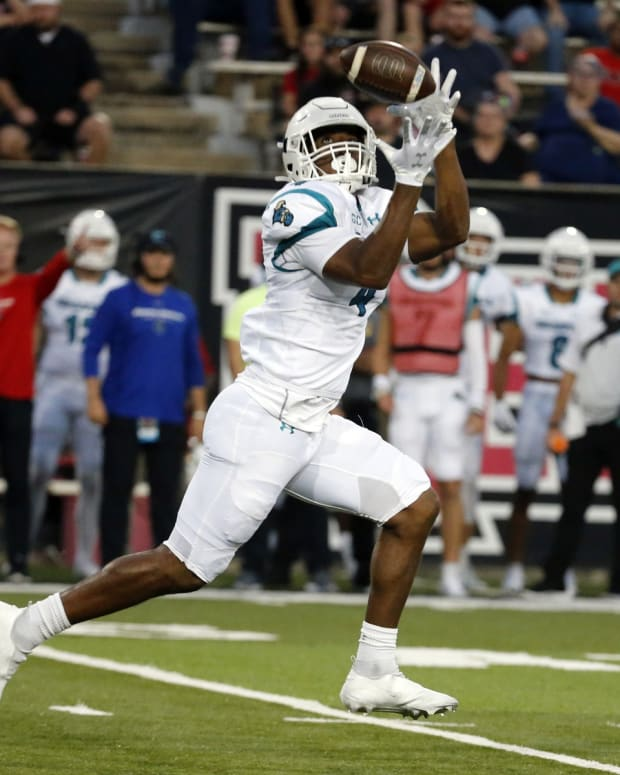 Oct 7, 2021; Jonesboro, Arkansas, USA; Coastal Carolina Chanticleers tight end Isaiah Likely (4) catches a pass for a touchdown during the first half against the Arkansas State Red Wolves at Centennial Bank Stadium.