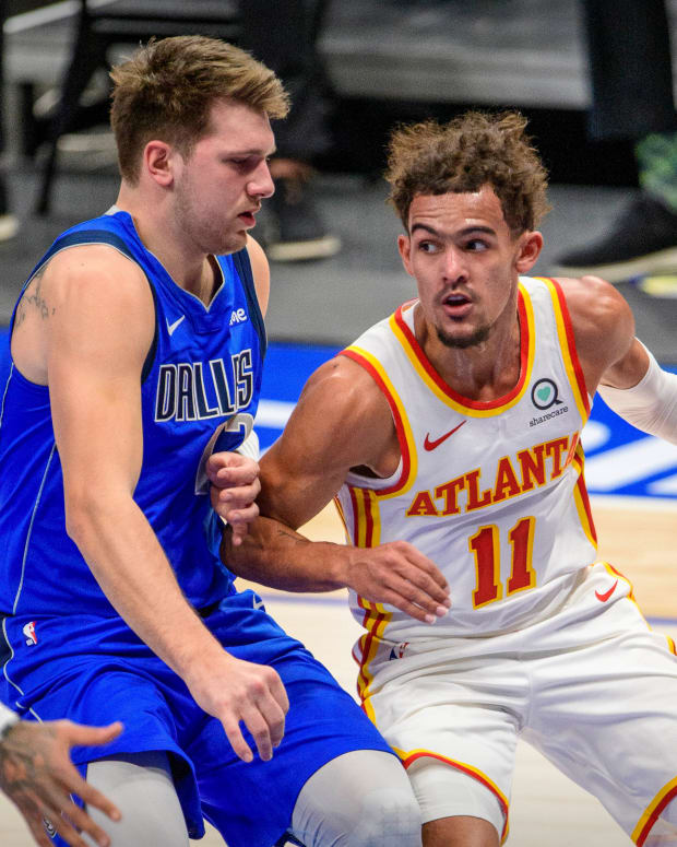 Dallas Mavericks guard Luka Doncic (77) defends against Atlanta Hawks guard Trae Young (11) during the first quarter at the American Airlines Center.