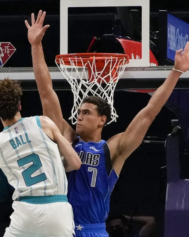 Oct 13, 2021; Charlotte, North Carolina, USA; Charlotte Hornets guard LaMelo Ball (2) goes to the basket defended by Dallas Mavericks center Dwight Powell (7) during the first half at Spectrum Center. Mandatory Credit: Jim Dedmon-USA TODAY Sports