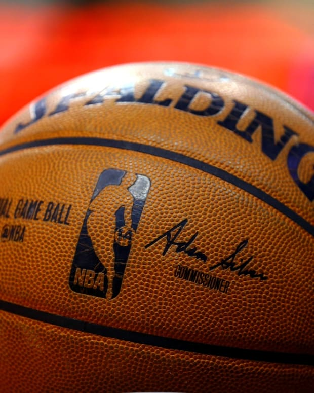 Nov 5, 2014; Phoenix, AZ, USA; Detailed view of the signature of NBA commissioner Adam Silver stamped on an official Spalding basketball prior to the game between the Memphis Grizzlies against the Phoenix Suns at US Airways Center. The Grizzlies defeated the Suns 102-91. Mandatory Credit: Mark J. Rebilas-USA TODAY Sports