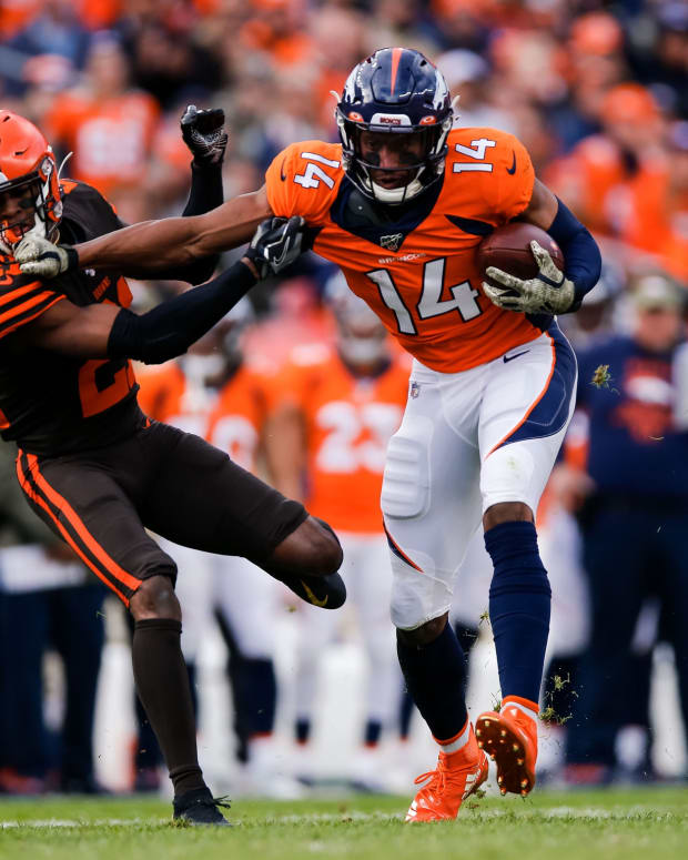 Denver Broncos wide receiver Courtland Sutton (14) stiff arms Cleveland Browns cornerback Denzel Ward (21) on a run in the first quarter at Empower Field at Mile High.