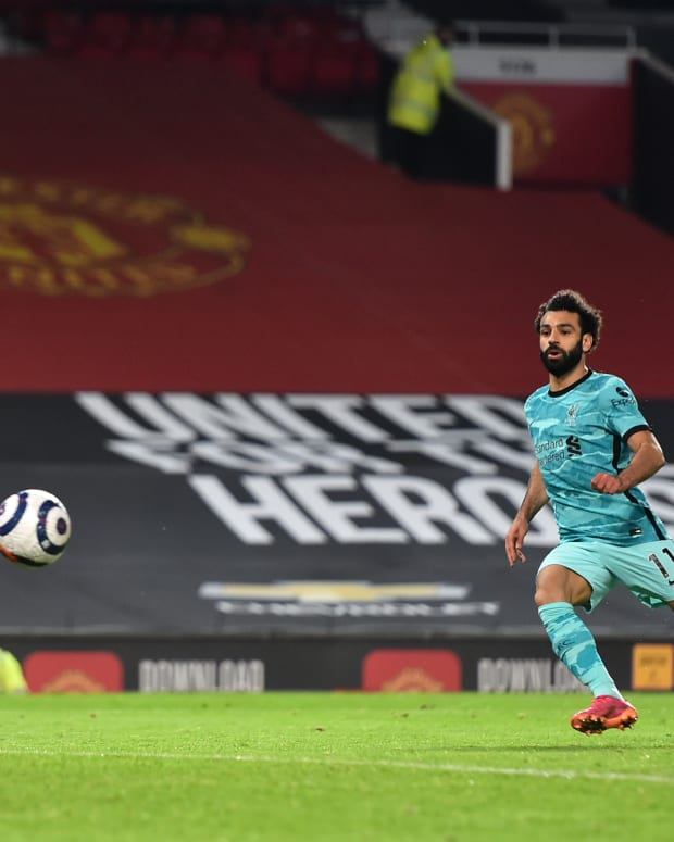 Liverpool's Mohamed Salah scores their fourth goal of the game during the Premier League match at Old Trafford, Manchester.