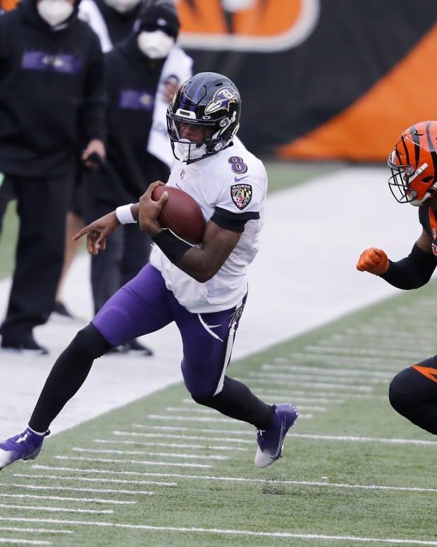 Jan 3, 2021; Cincinnati, Ohio, USA; Baltimore Ravens quarterback Lamar Jackson (8) defended by Cincinnati Bengals cornerback Darius Phillips (23) during the first quarter at Paul Brown Stadium. Mandatory Credit: Joseph Maiorana-USA TODAY Sports
