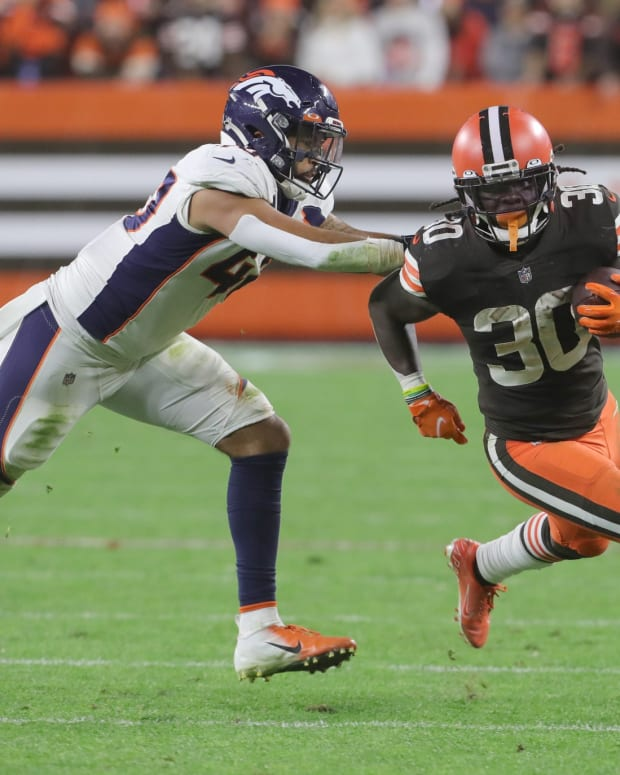 Cleveland Browns running back D'Ernest Johnson gets away from Denver's Justin Strnad on Thursday, Oct. 21, 2021 in Cleveland, Ohio, at FirstEnergy Stadium. The Browns won the game 17-14. [Phil Masturzo/ Beacon Journal] Browns5