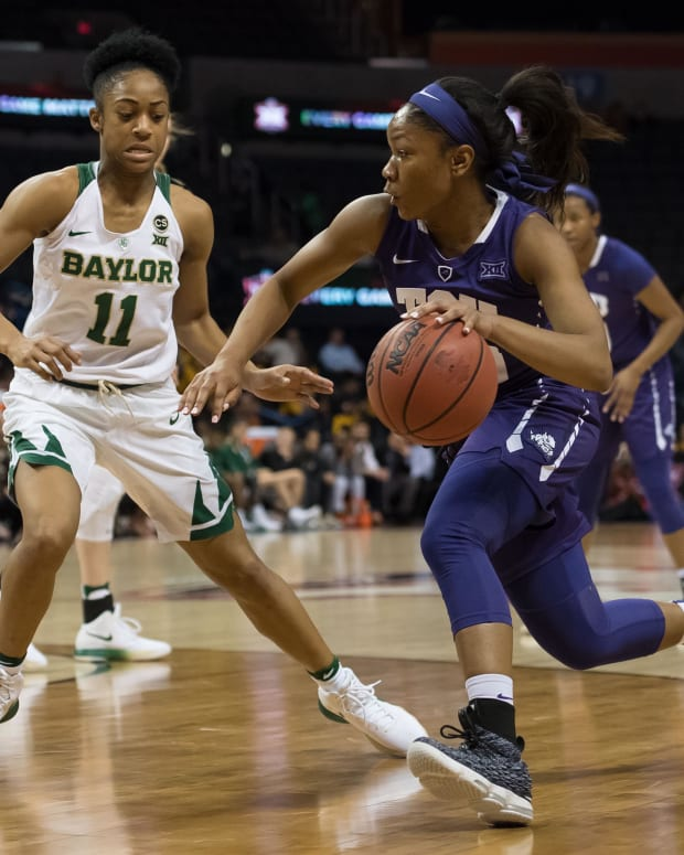 Mar 4, 2018; Oklahoma City, OK, USA; TCU Horned Frogs guard Lauren Heard (20) dribbles past Baylor Bears guard Alexis Morris (11) during the third quarter during the women's Big 12 Conference Tournament at Chesapeake Energy Arena.