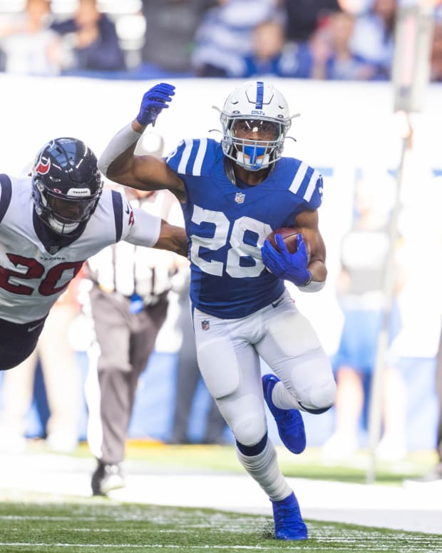 Oct 17, 2021; Indianapolis, Indiana, USA; Indianapolis Colts running back Jonathan Taylor (28) runs the ball while Houston Texans safety Justin Reid (20) defends in the second half at Lucas Oil Stadium.