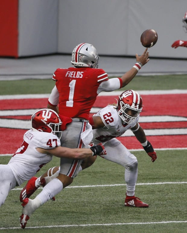 Former Ohio State quarterback Justin Fields attempts a pass in last year's Indiana vs. Ohio State matchup.