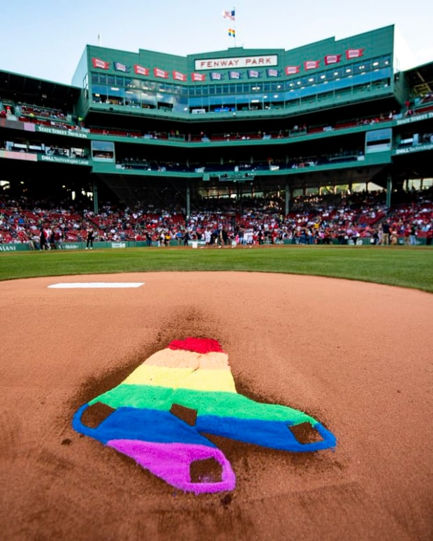 BOSTON, MA - JUNE 11: The Boston Red Sox rainbow logo is displayed in the dirt on the pitcher's mound in recognition of Pride night before a game against the Texas Rangers on June 11, 2019 at Fenway Park in Boston, Massachusetts. (Photo by Billie Weiss/Boston Red Sox/Getty Images)