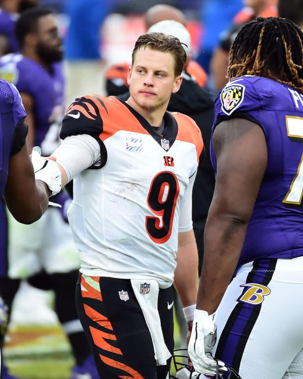 Oct 11, 2020; Baltimore, Maryland, USA; Cincinnati Bengals quarterback Joe Burrow (9) talks to Baltimore Ravens defensive end Calais Campbell (93) after the game at M&T Bank Stadium. Mandatory Credit: Evan Habeeb-USA TODAY Sports