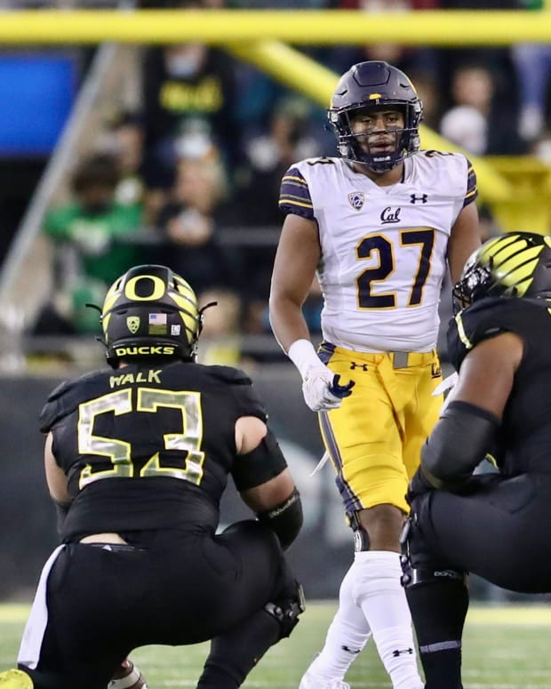 Cal's Trey Paster (27) lines up against Oregon.