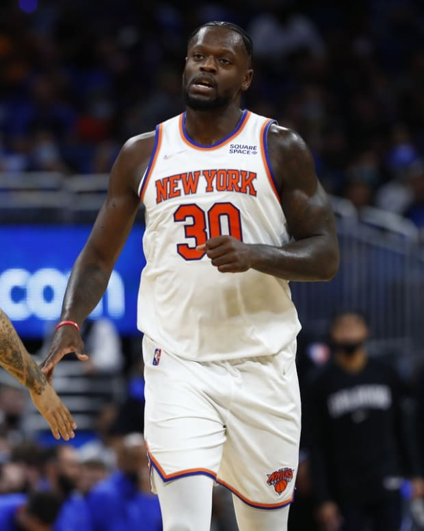 Oct 22, 2021; Orlando, Florida, USA; New York Knicks forward Julius Randle (30) is congratulated by New York Knicks guard Evan Fournier (13) during the second half at Amway Center. Mandatory Credit: Kim Klement-USA TODAY Sports