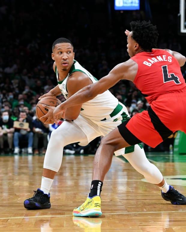 Oct 22, 2021; Boston, Massachusetts, USA; Boston Celtics forward Grant Williams (12) looks to pass around Toronto Raptors forward Scottie Barnes (4) during the second half at the TD Garden. Mandatory Credit: Brian Fluharty-USA TODAY Sports