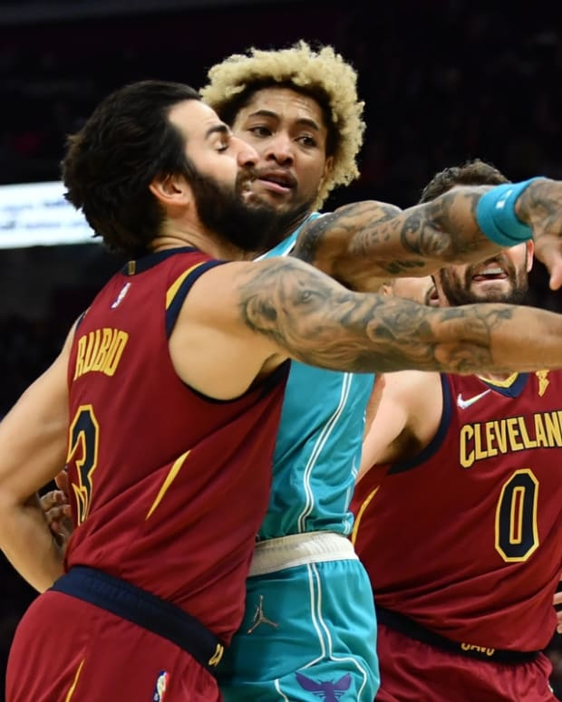 Oct 22, 2021; Cleveland, Ohio, USA; Charlotte Hornets guard Kelly Oubre Jr. (12) fouls Cleveland Cavaliers guard Ricky Rubio (3) during the second half at Rocket Mortgage FieldHouse. Mandatory Credit: Ken Blaze-USA TODAY Sports