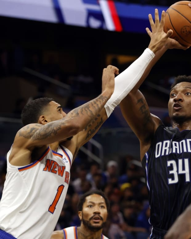 Oct 22, 2021; Orlando, Florida, USA; Orlando Magic center Wendell Carter Jr. (34) shoots as New York Knicks forward Obi Toppin (1) defends during the second half at Amway Center. Mandatory Credit: Kim Klement-USA TODAY Sports