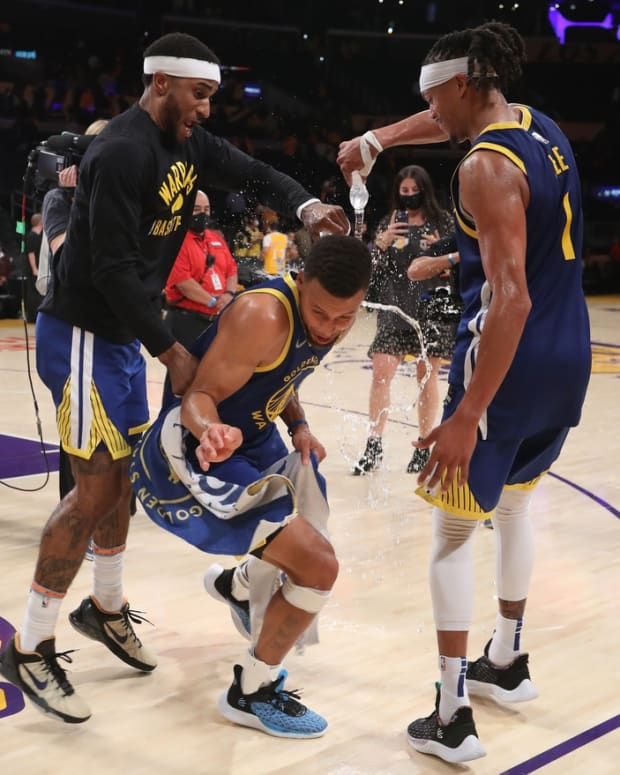 Oct 19, 2021; Los Angeles, California, USA; Golden State Warriors guard Gary Payton II (0) and guard Damion Lee (1) shower water over Golden State Warriors guard Stephen Curry (30) after the Warriors defeated the Los Angeles Lakers 121-114 at Staples Center. Mandatory Credit: Kiyoshi Mio-USA TODAY Sports