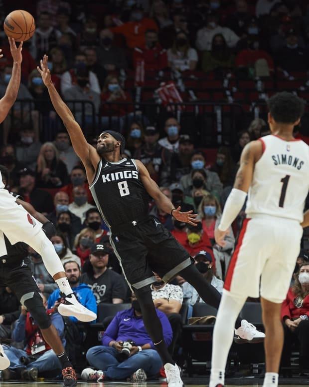 Oct 20, 2021; Portland, Oregon, USA; Sacramento Kings forward Maurice Harkless (8) defends Portland Trail Blazers guard CJ McCollum (3) during the second half at Moda Center. The Kings won 124-121. Mandatory Credit: Troy Wayrynen-USA TODAY Sports