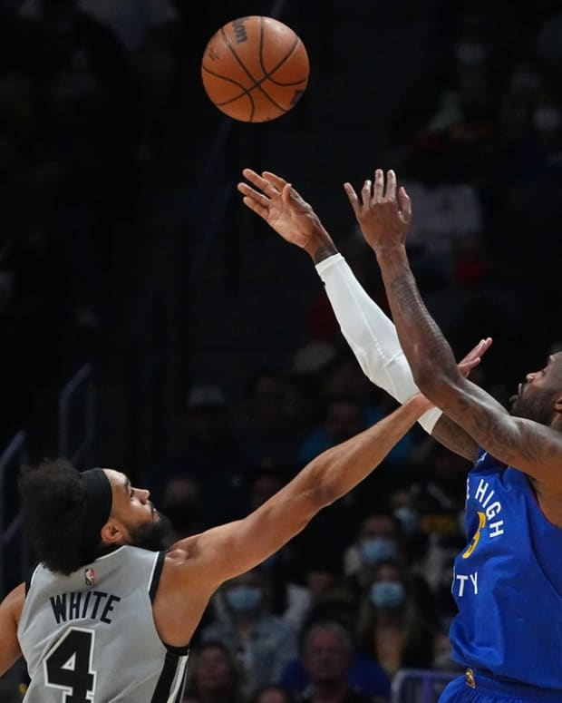 Oct 22, 2021; Denver, Colorado, USA; Denver Nuggets forward Will Barton (5) shoots over San Antonio Spurs guard Derrick White (4) in the second half at Ball Arena. Mandatory Credit: Ron Chenoy-USA TODAY Sports